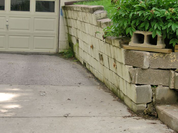 a failing retaining wall around a driveway in Everett