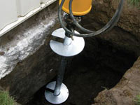 Installing a helical pier system in the earth around a foundation in Edmonds