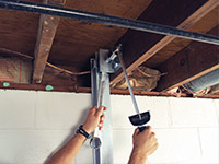 Straightening a foundation wall with the PowerBrace™ i-beam system in a Oak Harbor home.