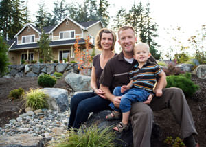A happy family outside a home with a repaired foundation in Friday Harbor
