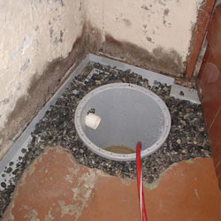 Installing a sump in a sump pump liner in a Bothell home