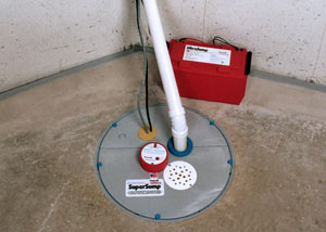 A sump pump system with a battery backup system installed in Stanwood