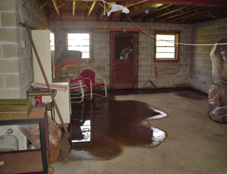 a flooded basement floor in a Darrington home