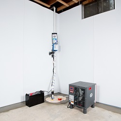 Sump pump system, dehumidifier, and basement wall panels installed during a sump pump installation in Arlington