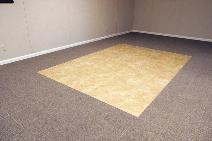 tiled and carpeted basement flooring installed in a Edmonds home