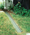 A recessed gutter drain extension installed in Darrington, Washington