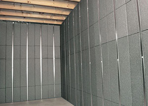 SilverGlo™ insulation and metal studs making up our Basement to Beautiful panels.  Installed in Lynwood.